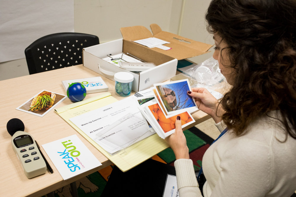 Beata Royzman looks through image cards for speech exercises ahead of a session with a patient in Lehman College's new Parkinson's disease clinic. Royzman is a graduate student in Lehman's speech-language pathology program.