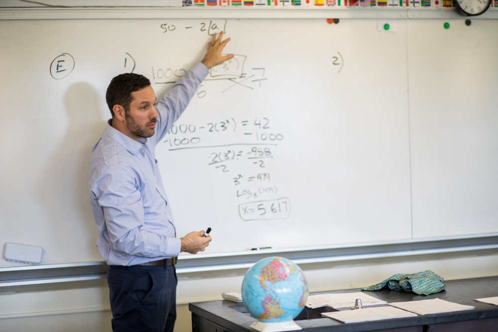 Jason Garofalo explains an algebra equation as part of an in-class exercise at the Marble Hill School for International Studies. Garofalo teaches mathematics through Math for America, a nonprofit organization that recruits math and science teachers.