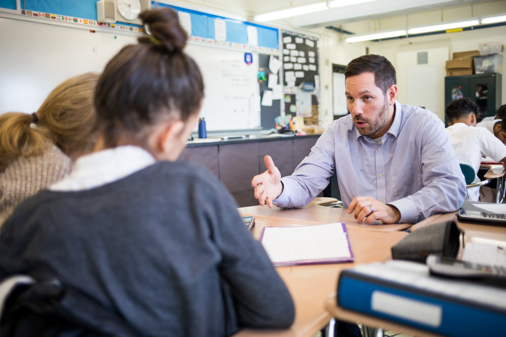 Jason Garofalo helps a student understand an algebra equation at the Marble Hill School for International Studies. Garofalo teaches mathematics through Math for America, a nonprofit organization that recruits math and science teachers and helps them mold students into scientists and mathematicians.