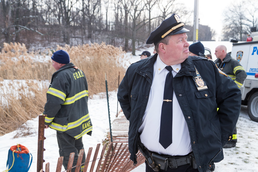 Deputy Inspector Terence O'Toole stands by during a water rescue at the Van Cortlandt Park golf course in January. O'Toole's tenure as commanding officer of the 50th Precinct came to an end when he was transferred to the New York Police Department's Chief of Department's office at the stroke of midnight Nov. 20. Capt. Emilio Melendez, a nearly 30-year veteran of the police force, succeeds O'Toole.
