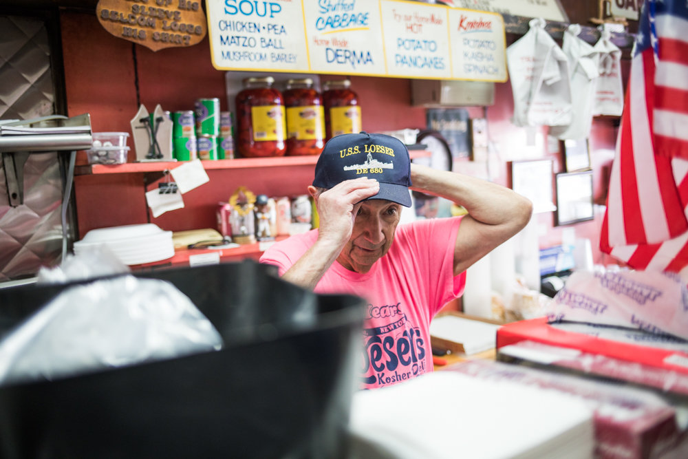 Fredy Loeser adjusts his cap in his eponymously named eatery on West 231st Street. Loeser's daughter, Pamela Halpern, has mounted a long-running — but now seemingly stalled — campaign to rename West 231st Street after her father's beloved eatery.