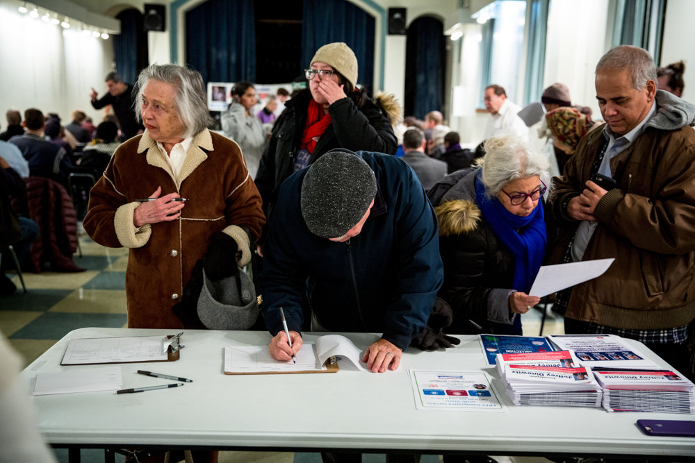 Residents sign in at a town hall geared towards discussing neighborhood priorities with local elected officials, including state senator-elect Alessandra Biaggi, Councilman Andrew Cohen and Assemblyman Jeffrey Dinowitz, at Vladeck Hall.