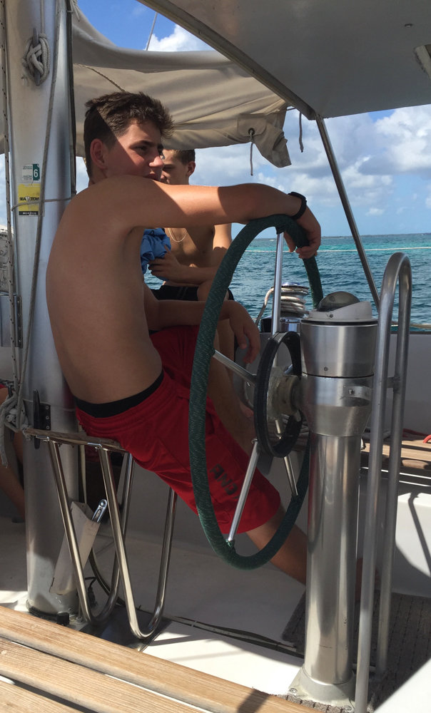 Theodore Mitchell sits at the wheel of a boat in the Boy Scouts' sea base in the Bahamas in 2016. Working toward Eagle Scout, Mitchell will lead a bone marrow drive at the Riverdale Presbyterian Church on Dec. 15 where he will gain his last merit badge.
