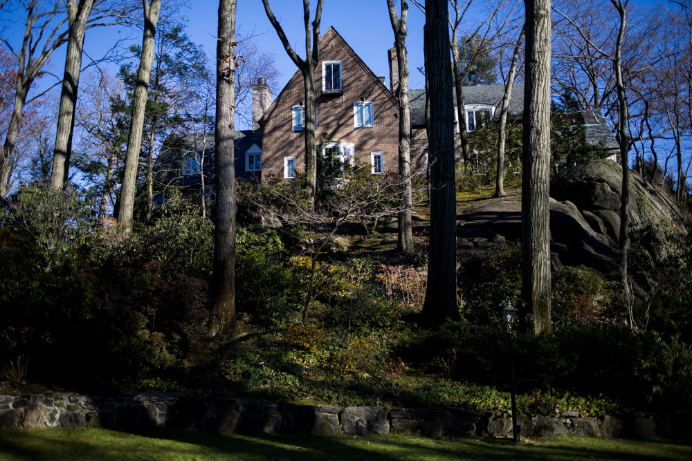 Surrounded by trees, a house sits atop a rocky outcropping along Fieldston Road, in an area known as the Special Natural Area District. The SNAD designation, which exists in both the Bronx and Staten Island, is designed to protect the natural aspects of the area, including steep slopes and trees. The city's proposed changes to SNAD would lump Fieldston, Riverdale and Staten Island together — a proposal CB8 land use chair Charles Moerdler strongly opposes.