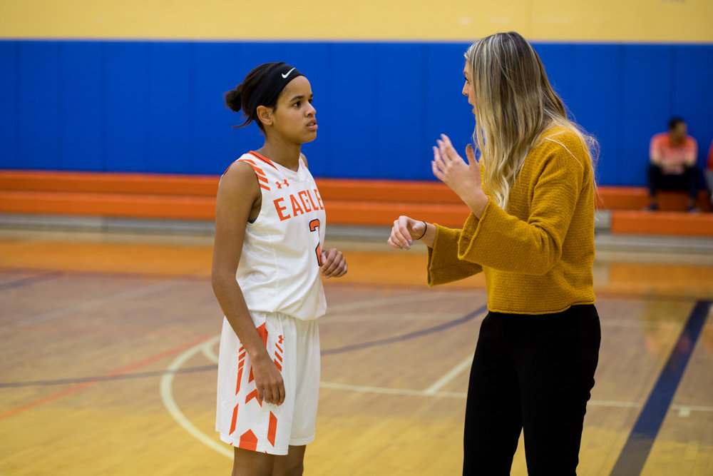 Maeve Parahus gives instruction to Anabelle Wright during the Eagles 55-10 victory over Nightingale Bamford last week. The former Manhattan College basketball star has Fieldston off to a 3-1 start to its season.