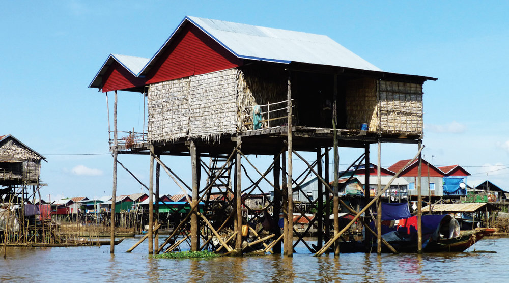 While visiting Kompong Khleang in Cambodia, Bill Caplan captured an image of a house on stilts. During the high-water season in the country, according to Caplan, water rises and covers those stilts.