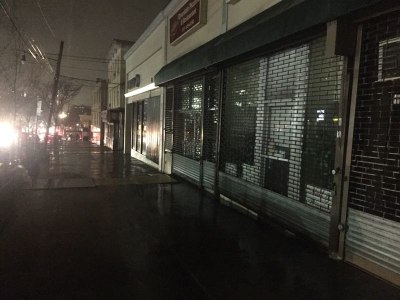 Riverdale Avenue between West 256th and 259th streets sits in darkness Sunday night after a manhole fire nearby cut electricity to more than 100 Con Edison customers.