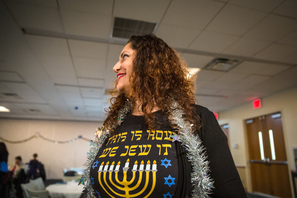 Roberta Kraus wears a shirt that reads 'This is how we Jew it' at the Hannukah celebration hosted by Congregation Beth Aharon at the Hebrew Institute of Riverdale. The Sephardic congregation is filled with members from many different countries, and continues to grow every year. It recently celebrated its 20th anniversary in the Bayit.