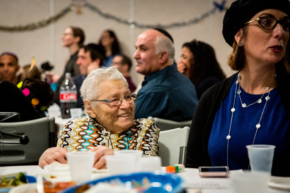 Charlotte Cohen, 95, smiles at a Hanukkah celebration held by Congregation Beth Aharon at the Hebrew Institute of Riverdale. The Sephardic congregation recently celebrated its 20th anniversary, honoring the founders of their organization.