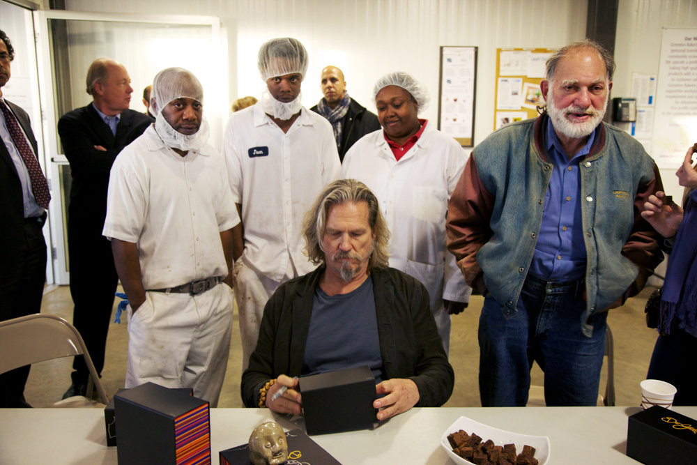 Actor Jeff Bridges, center, takes a tour of Greyston Bakery in Yonkers with Bernard Glassman, right. Glassman founded the bakery in 1982 as a way to provide jobs for people from disadvantaged backgrounds.