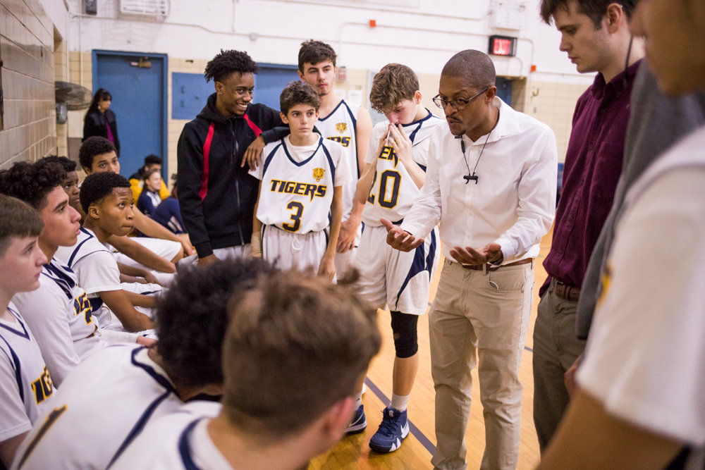 First-year head coach Courtney Bradshaw talks things over with his Riverdale/Kingsbridge Academy boys basketball team during the Tigers win over IN-Tech last week.
