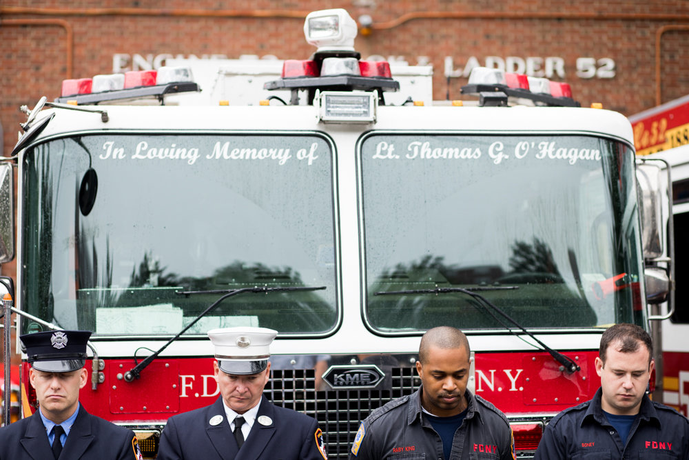 Firefighters with Ladder 52 stand for one of six moments of silence on Sept. 11. Ladder 52 dedicated one of its trucks to Lt. Thomas O'Hagan, a Riverdale resident who got his start as a firefighter at the Hudson Hudson Parkway East company. O'Hagan died on Sept. 11, 2001.