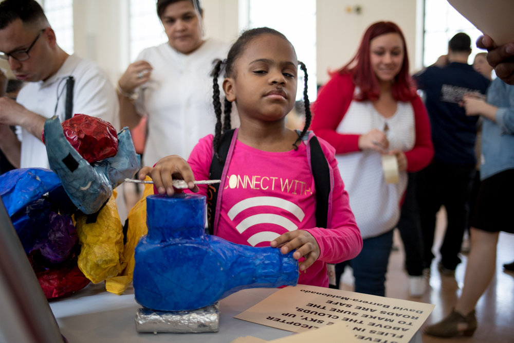 Janicesa Rodriguez, a student at Lavelle School for the Blind, feels a sculpture at the school's third annual art exhibit, Vision of Art, on April 13. The school brings together works of art by its students that visitors are encouraged to interact with, upending conventional notions of exhibitions where visitors are generally prohibited from touching the art.