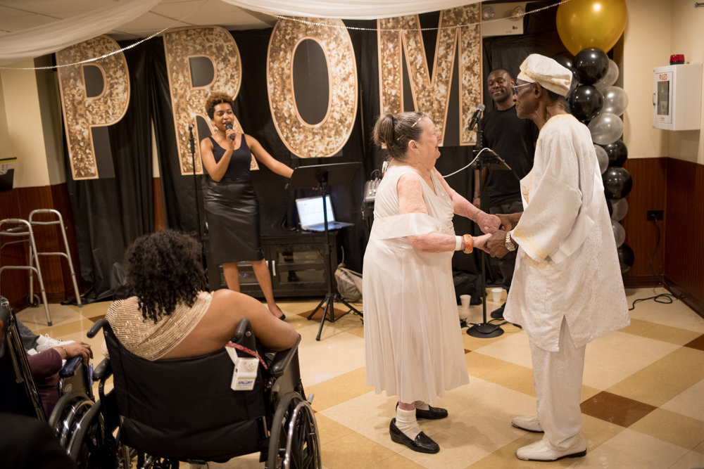 Marion Dolan and Carl Alexander dance to Etta James' 'At Last' at the Senior/Senior Prom at the Park Gardens Rehab and Nursing Center on June 21. The event brought together Park Gardens residents with students from Marble Hill School for International Studies. Dolan and Alexander were crowned prom queen and king.