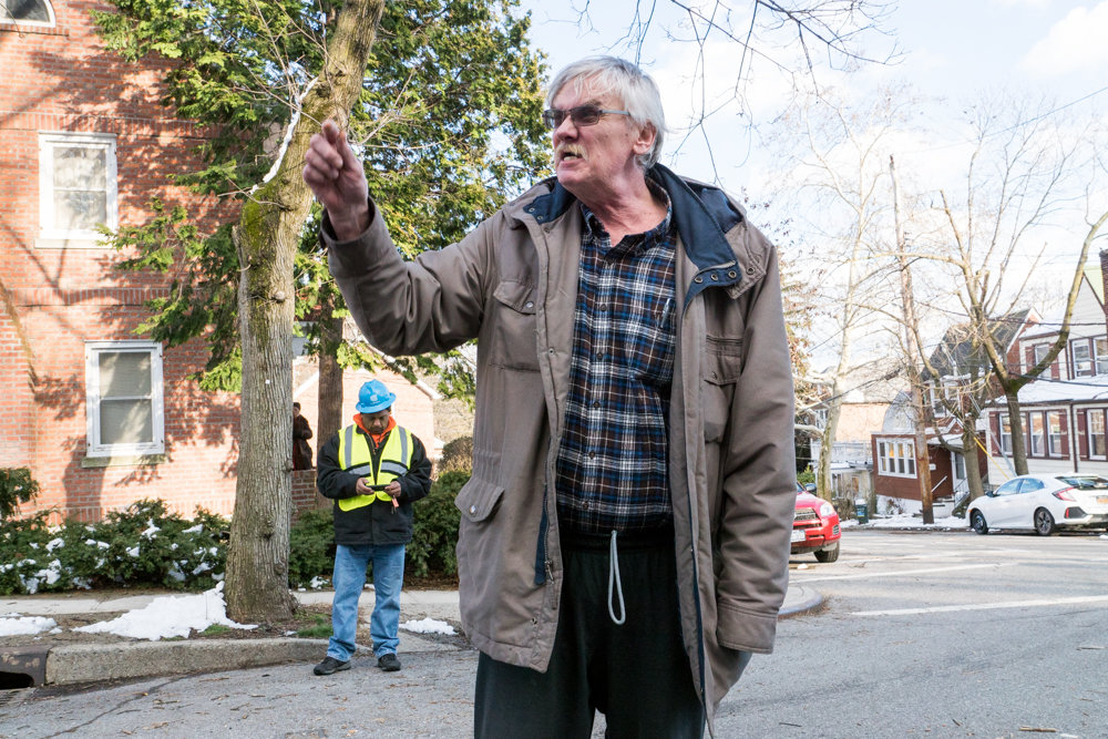 Alex Perzow curses a ConEd worker and politicians who he says failed to resolve a weeklong power outage along Sylvan Avenue between West 256th and West 254th streets. A massive tree collapsed during a March 2 storm, tearing down power lines, leaving live wires dangling, and blocking access to vehicles and pedestrians.