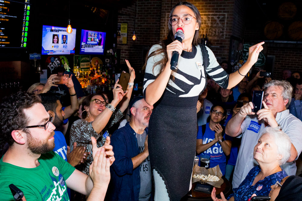 Alexandria Ocasio-Cortez — U.S. Representative-elect for New York's 14th congressional district, who toppled incumbent Rep. Joseph Crowley last June — gives a speech at the Bronx Alehouse after Alessandra Biaggi's Democratic primary win against state Sen. Jeffrey Klein on Sept. 13.