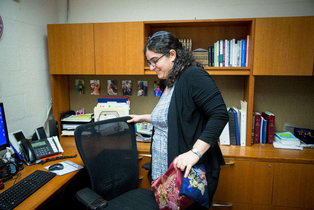 Rabbi Katie Greenberg packs up her office and grabs her tallit bags at the Conservative Synagogue Adath Israel of Riverdale. Greenberg is the synagogue's new engagement and programming director.