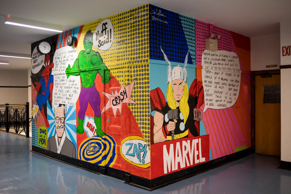 Delania Alma spent a few days painting a mural of Stan Lee and his superhero creations at DeWitt Clinton High School, where Lee graduated from in 1939.
