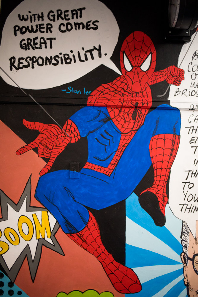 Spider-Man, perhaps Stan Lee's most iconic creation, is part of a mural dedicated to Lee and his legacy at DeWitt Clinton High School, painted by Delania Alma. Lee died last November at 95.