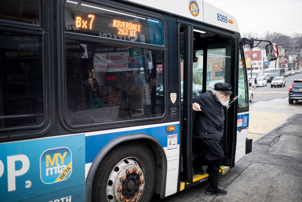 A commuter departs a Bx7 bus in North Riverdale. The MTA is scheduled to vote in January on raising fares while reducing bus and subway service — an outrage to some aggrieved commuters who reluctantly rely on the authority's floundering mass transit network.