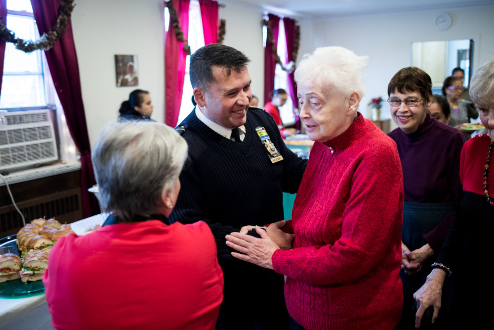 The 50th Precinct's new commanding officer, Emilio Melendez, speaks with parishioners at a Christmas party at the St. John-Visitation Parish Pastoral Center. Melendez feels that his predecessor, Deputy Inspector Terence O'Toole, did a good job, though he has plans to change some things in the 5-0.