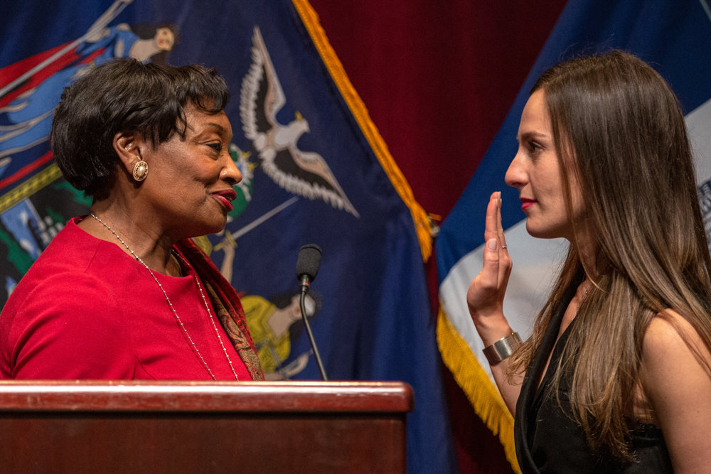 Senate majority leader Andrew Stewart-Cousins, left, swears in Alessandra Biaggi as a state senator at Lehman College last Sunday. Biaggi began an insurgent campaign early last year that culminated in her ousting former Independent Democratic Conference leader Jeffrey Klein.