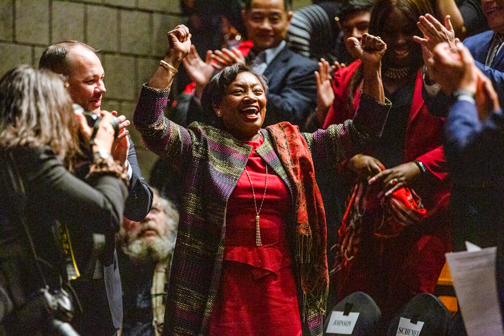 Senate majority leader Andrea Stewart-Cousins cheers with the crowd ahead of administering the oath of office to new state Sen. Alessanda Biaggi at Lehman College on Jan. 6.
