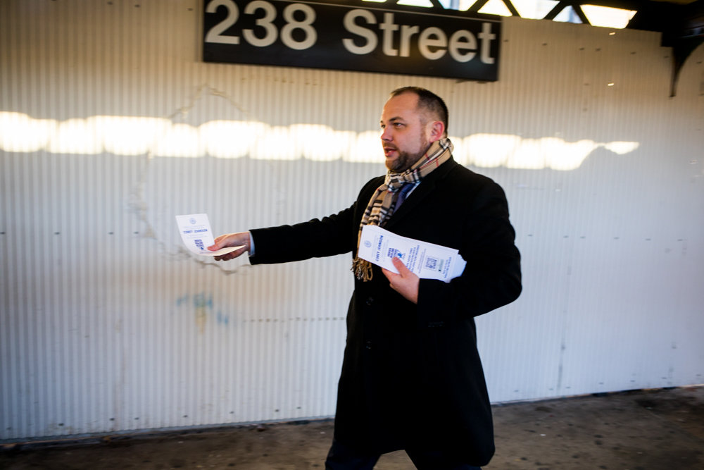 With surveys in hand, city council Speaker Corey Johnson, the acting public advocate, walks toward commuters disembarking from an uptown 1 train at West 238th Street and Broadway on Jan. 11. Other local elected officials, including Councilman Andrew Cohen, joined Johnson on a five-day transit tour to hear from riders on how their commutes could be better.