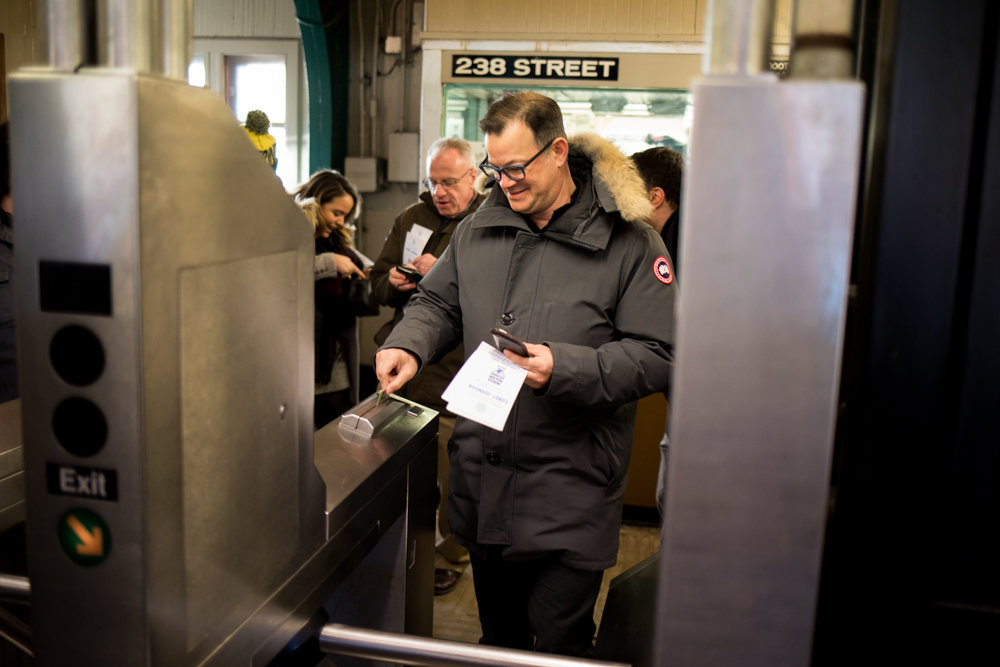 Councilman Andrew Cohen swipes his MetroCard to step onto the downtown 1 train platform at West 238th Street to join acting public advocate and city council Speaker Corey Johnson's transit tour on Jan. 11, seeking riders' feedback on how their commutes could be better.