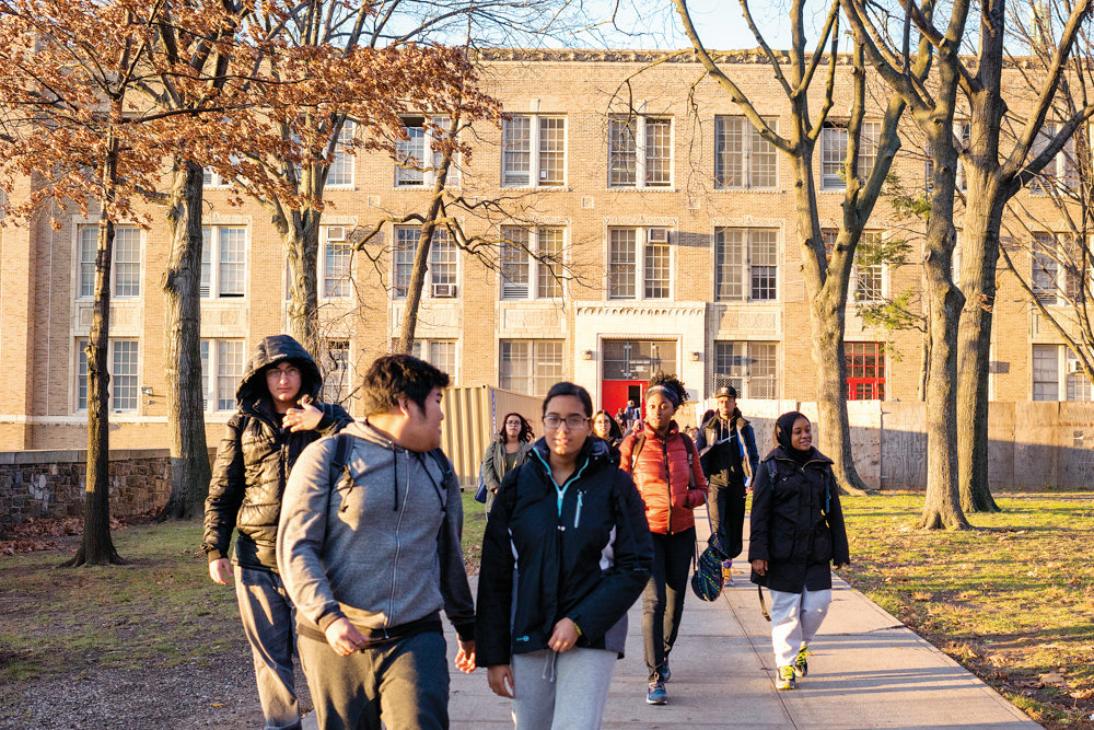 Students leave DeWitt Clinton High School after school in 2015. An alum of the school, Howard Levine, recently published his second novel, 'Last Gasp.'
