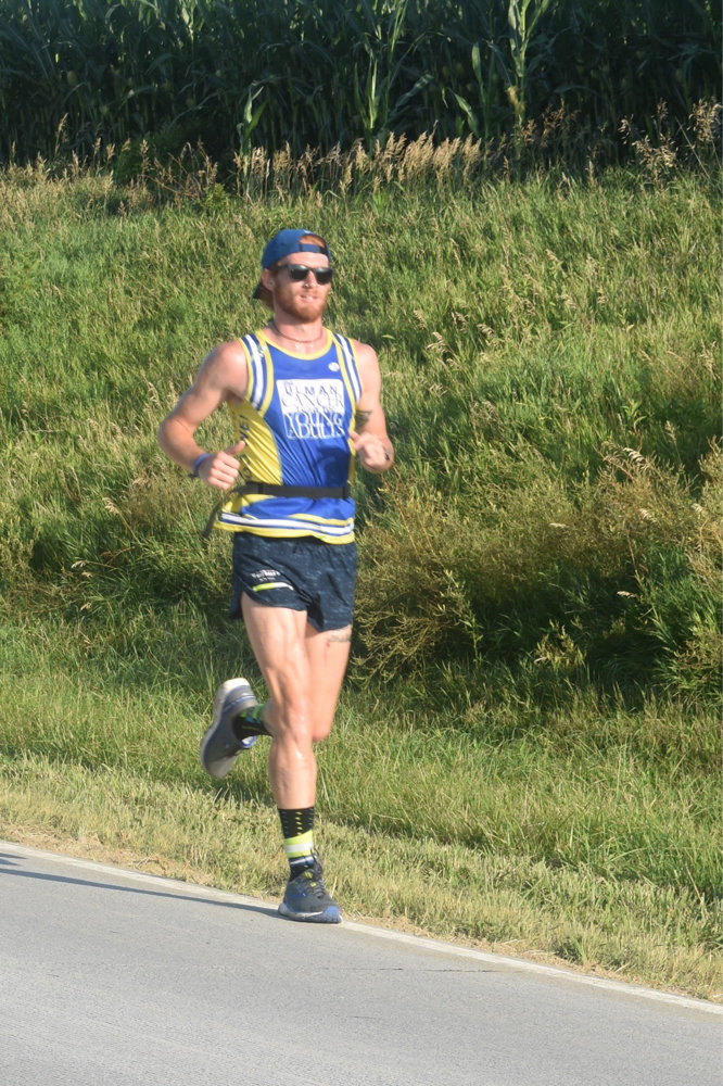 Matthew Billings runs on a road in Nebraska as part of his transcontinental 4,000-mile trek from San Francisco to New York City over the summer to raise awareness for the Ulman Cancer Fund for Young Adults.