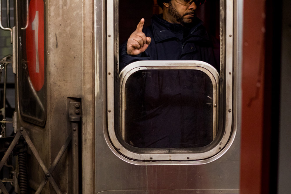 A train conductor points to the zebra board to confirm the alignment of an uptown 1 train at the West 96th Street station. The MTA reportedly receives up to $170 million in monthly reimbursements from the Federal Transit Administration. U.S. Sen. Charles Schumer is pushing to reopen the government as soon as possible to avoid what he described as a potentially negative impact a partial lapse in federal funding could have on commuters.
