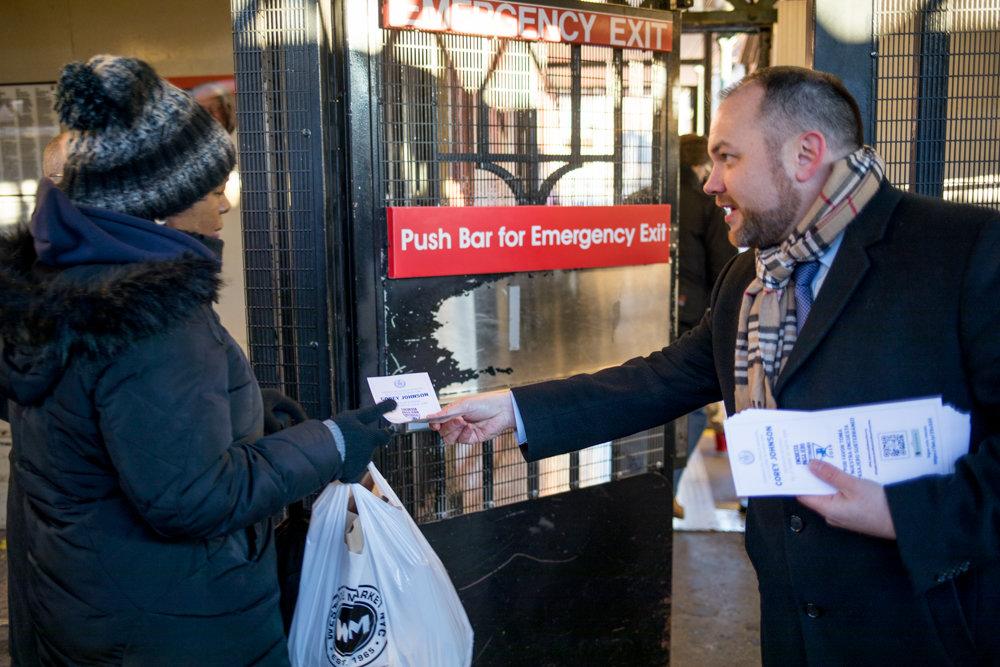 City council Speaker and acting public advocate Corey Johnson hands out a survey to a commuter leaving the uptown 1 train platform at West 238th Street on the last day of his five-borough transit tour Jan. 11. Johnson and other local elected officials led the initiative to better understand commuter plights and how they could fix them.