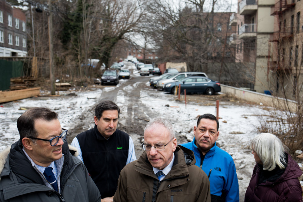 Councilman Andrew Cohen, left, speaks at a press conference about the potential fate of Old Albany Post Road, an unmarked ramshackle stretch of land sandwiched between Broadway and Post Road. The state owns the road, and Cohen — along with Assemblyman Jeffrey Dinowitz, center — is calling for the city to purchase it for the state's $1 asking price.