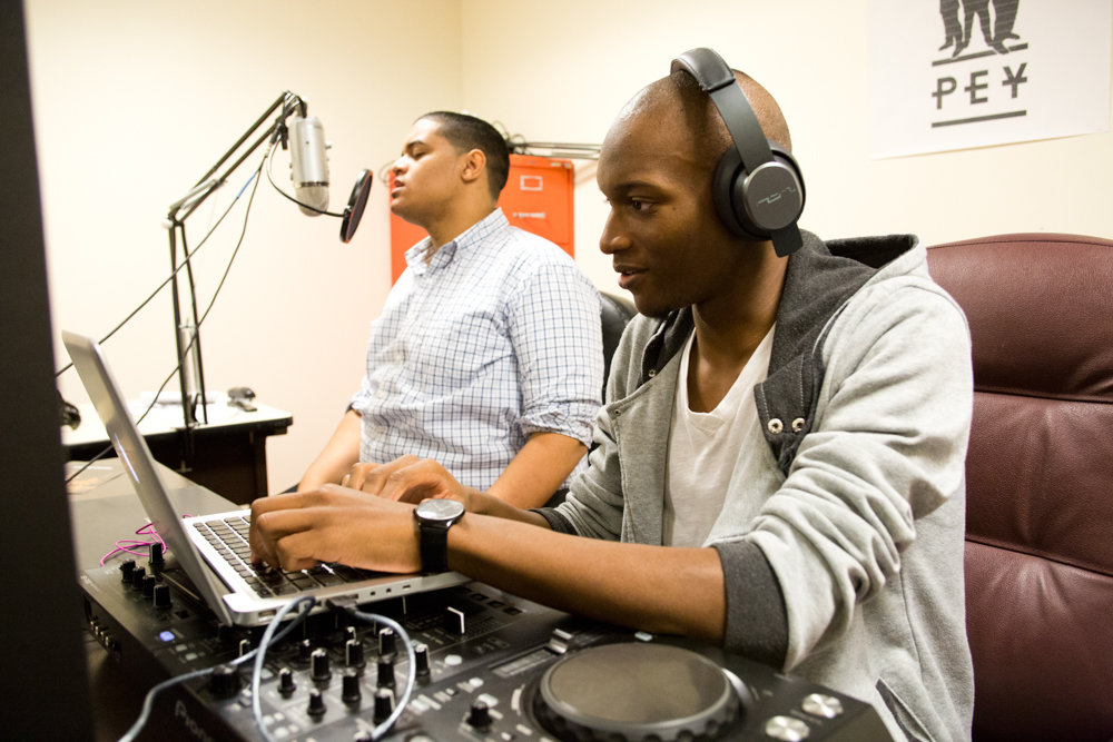Erick Jhon Peguero, left, and Poche Wilson host a program on Lehman College's student-run radio station in 2016. Whereas Lehman's radio station exists within a larger network of legitimate radio operations, pirate radio operators continue to broadcast illegally, including, apparently, near Spuyten Duyvil.
