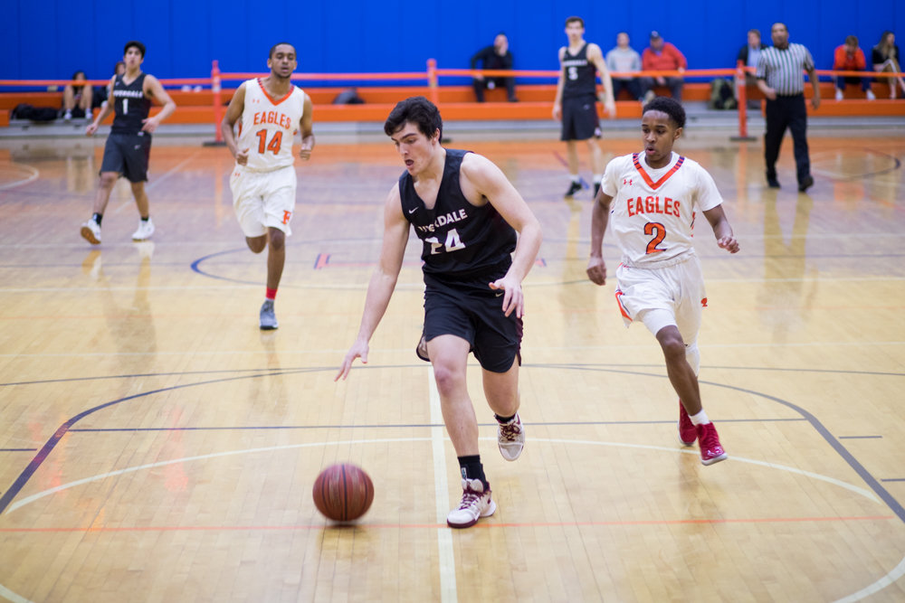 Riverdale's Sean O'Toole has clear sailing for an easy layup en route to two of his 12 points in the Falcons' victory over neighborhood rival Fieldston last week.