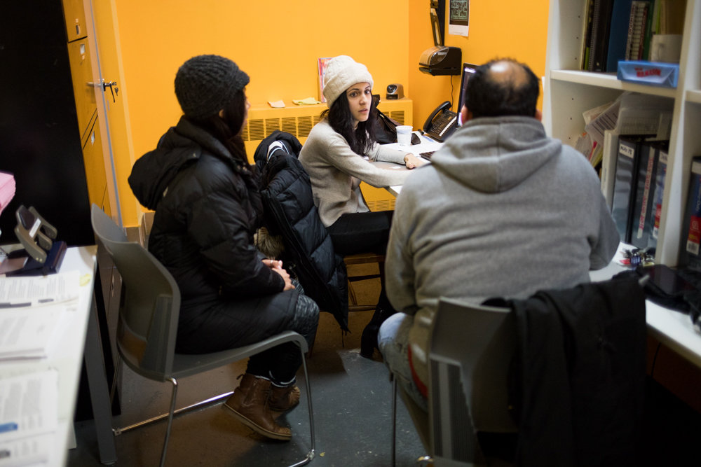 Kulsoom Ijaz, staff attorney for Bronx Legal Services, listens to visitors at a free housing clinic hosted by Community Action for Safe Apartments.