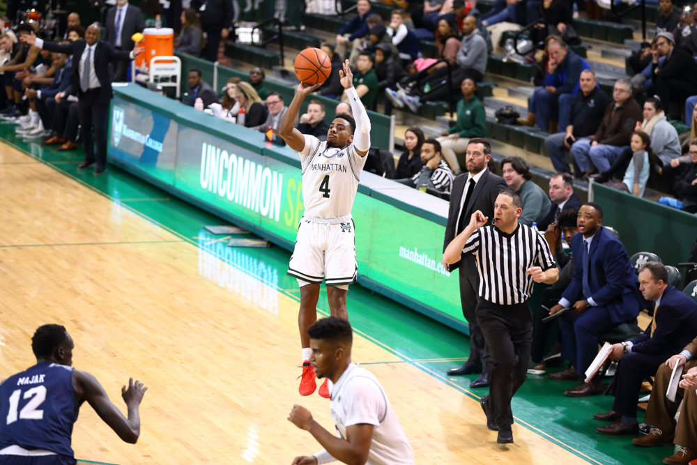 Manhattan's Samir Stewart lets fly with one of his four three-pointers in the Jaspers' victory over St. Peter's Saturday night.