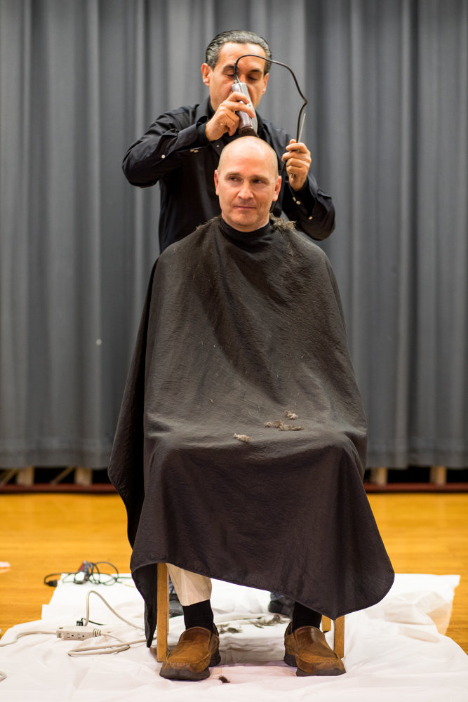 After students at St. Margaret of Cortona School surpassed their reading and fundraising goals, principal Hugh Keenan shaved his hair off.