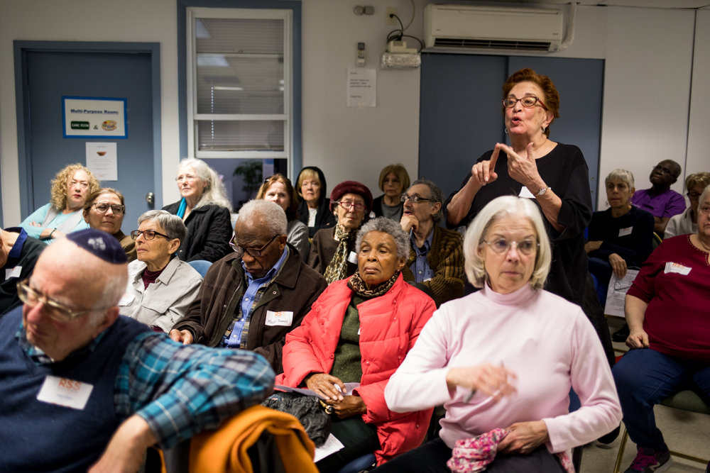 Judith Green asks state Sen. Alessandra Biaggi about how the New York Health Act will be funded at an information session at RSS-Riverdale Senior Services last week.