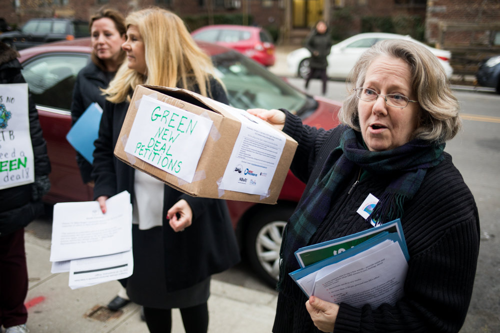 Jennifer Scarlott of Bronx Climate Justice North holds up a box full of petitions urging U.S. Rep. Eliot Engel to support implementing the sweeping so-called Green New Deal environmental measure to combat climate change while revamping the U.S. economy, in front of Engel's Johnson Avenue office Feb. 6. Engel was not in his Bronx office, as he was involved in a hearing in Washington on the ongoing Yemen civil war.