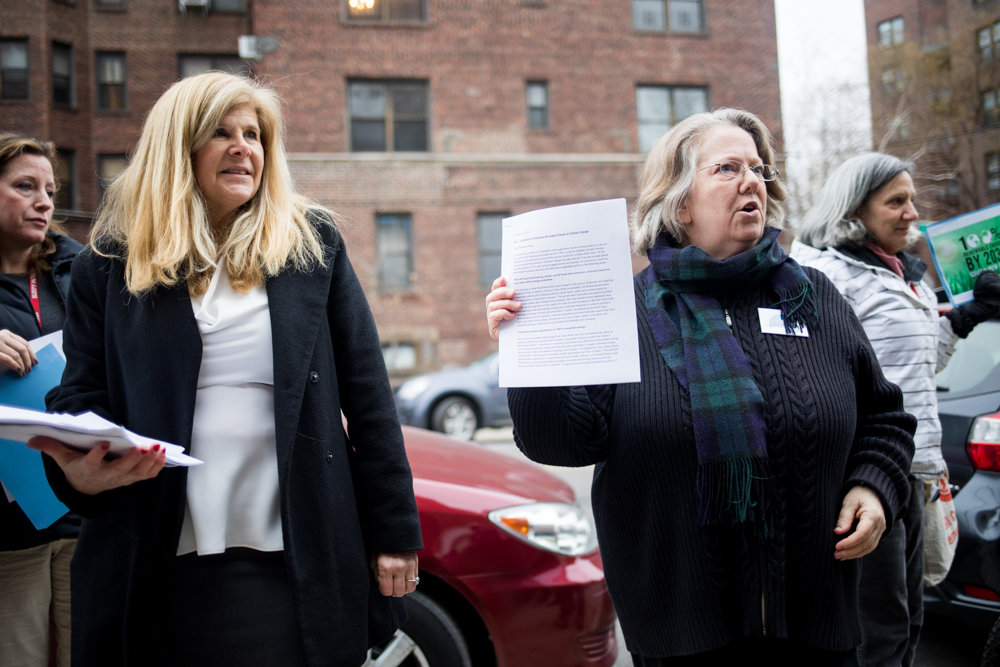 Environmental activist Jennifer Scarlott, right, talks about the petitions various climate and social justice organizations have compiled for U.S. Rep. Eliot Engel, urging him to take a lead role in pushing for a radical 'Green New Deal' to combat climate change. Scarlott also urged Engel, who was in Washington for a hearing on the Yemen war, to sign a pledge against taking fossil fuel money. But Lisa Tannenbaum, Engel's community outreach director, left, said the congressman doesn't sign pledges, but also takes no money from pro-fossil fuel groups.