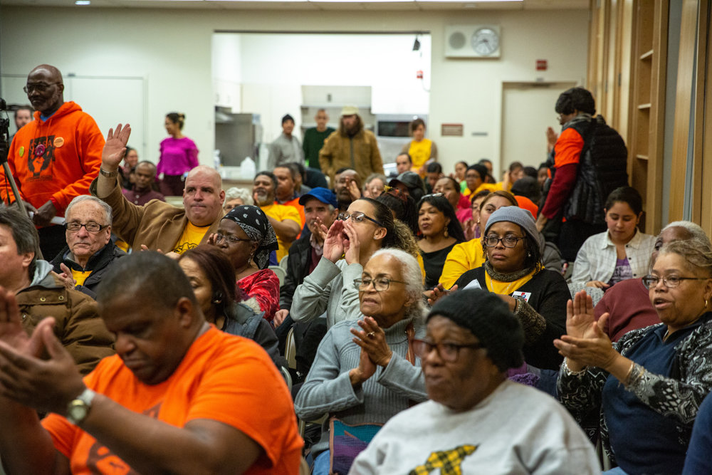 Audience members at a town hall cheer as state Sen. Alessandra Biaggi, Assemblywoman Nathalia Fernandez and Assemblyman Victor Pichardo vow to support tenants in a fight for universal rent control statewide.