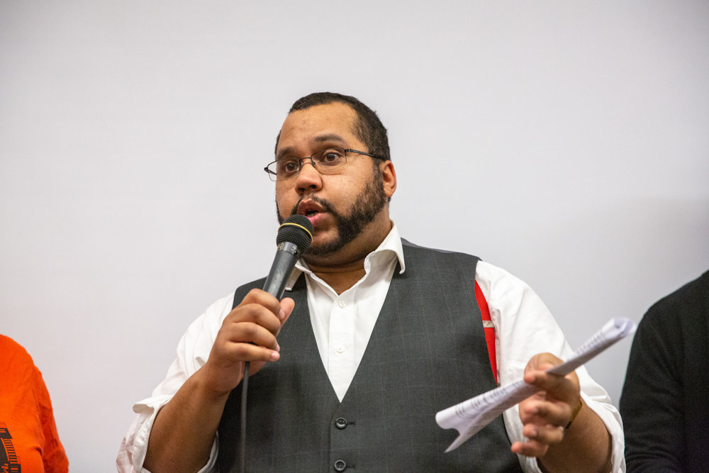 Assemblyman Victor Pichardo talks about his support for tenant rights at a rent control-focused town hall at the New Settlement Community Center on Jerome Avenue last week.