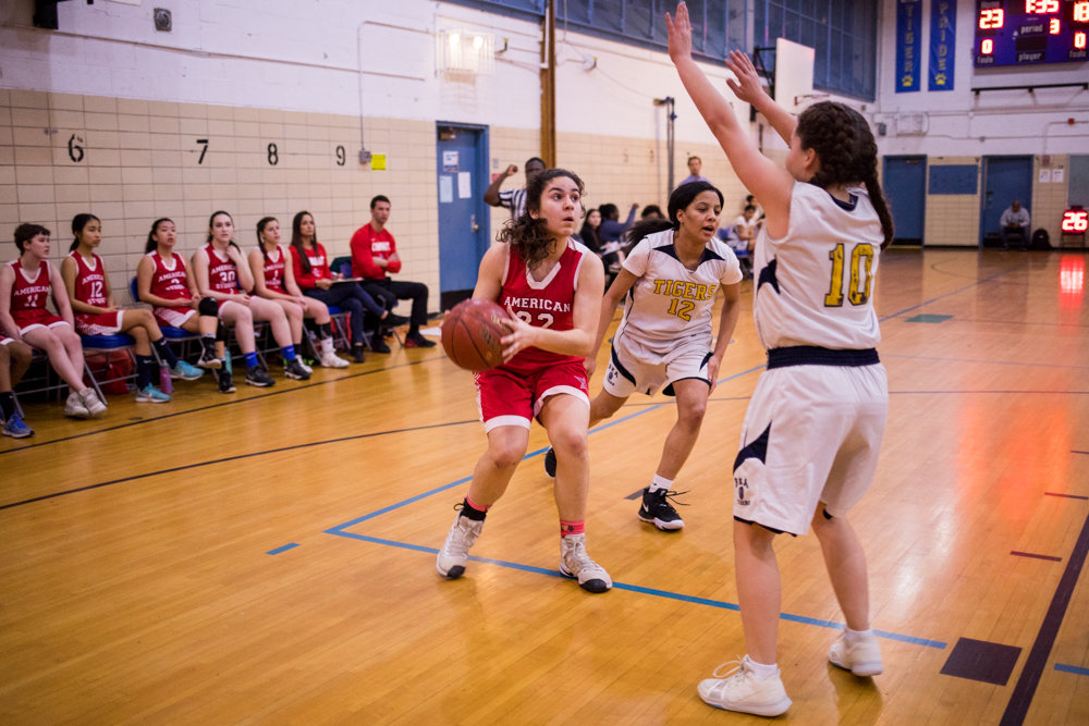 American Studies' Emily Eljamal drives for a layup against two Riverdale/Kingsbridge Academy defenders in the Senators' one-point win last Thursday.