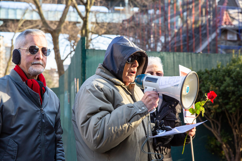 Bronx borough historian Lloyd Ultan talks about the history of the Villa Rosa Bonheur and its sister buildings, the Villa Charlotte Brontë and the Villa Victoria, at a vigil outside the historic Palisade Avenue apartment building, where ongoing demolition has upset many in the surrounding neighborhood.
