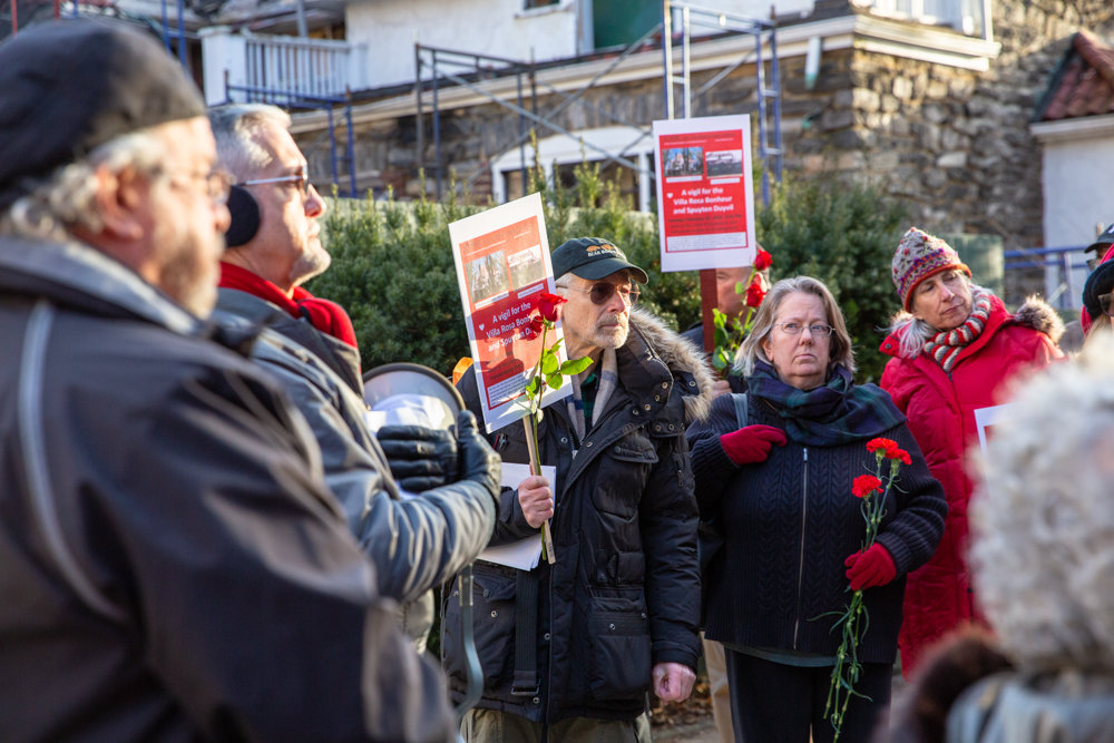 Community activists including Jennifer Scarlott, second from right, and Perry Brass, center, host a rally outside of the Villa Rosa Bonheur, a historic apartment building at 2395 Palisade Ave., the site of an ongoing demolition.