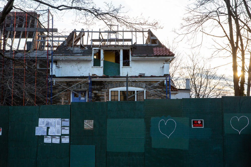 Two hearts are drawn on a construction barrier in front of the Villa Rosa Bonheur, a historic apartment building located at 2395 Palisade Ave., where a developer is working toward replacing it with a larger residential structure.
