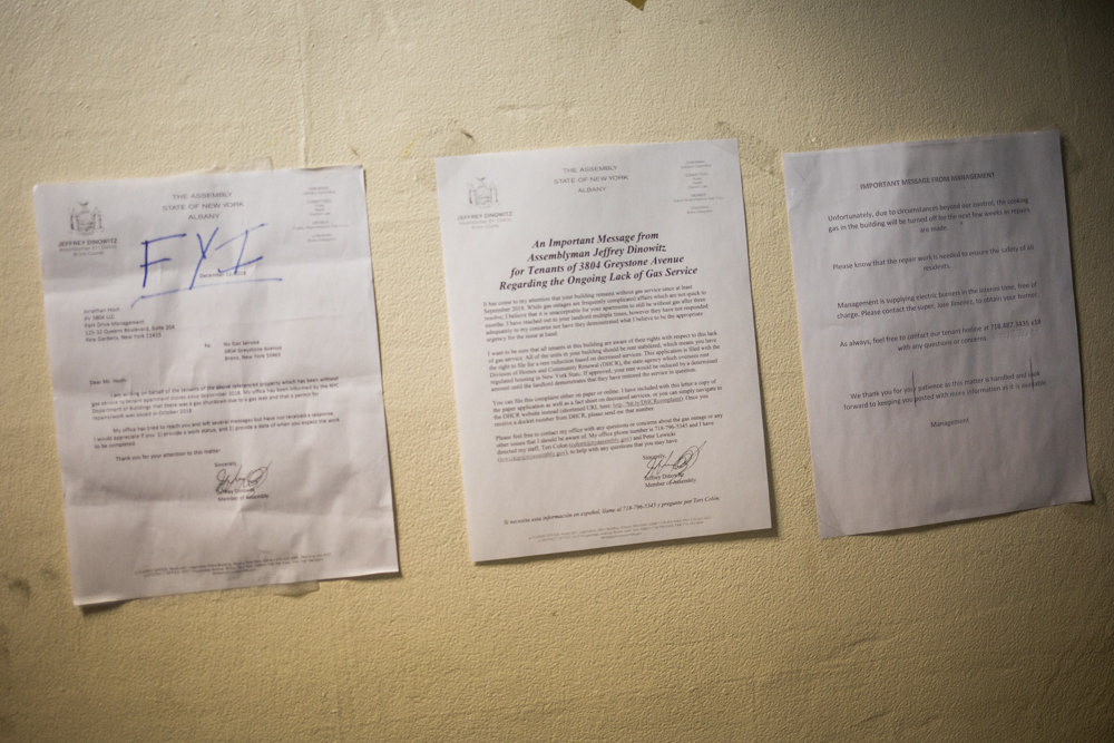 A collection of letters from Assemblyman Jeffrey Dinowitz and landlord Park Drive Management are posted on the drab wall inside 3804 Greystone Ave., where tenants have slogged along without cooking gas for half a year. A Park Drive spokesman said restoring gas to his rather rickety old building is anything but simple, but refused to elaborate on details.