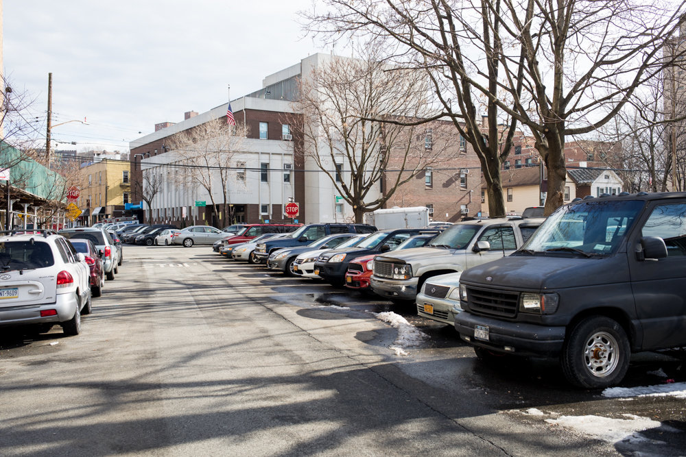 Cars are parked perpendicular to the sidewalk along West 236th Street near Kingsbridge Avenue. Such innovative parking practice — especially when done illegally — is one of several focal points of a new package of bills introduced by city council Speaker Corey Johnson and other council members Feb. 13.